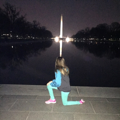 Ella at the edge of the Reflecting Pool